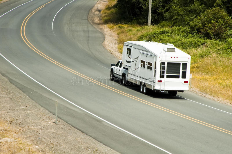 Recreational vehicles on the highway. Recreational vehicles traveling on the highway stock photo