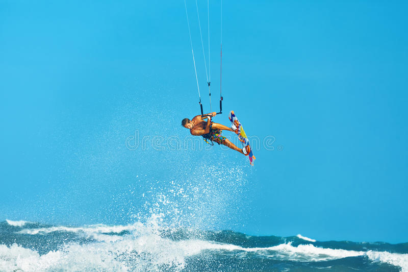 Recreational Water Sports Action. Kiteboarding Extreme Sport. Summer Fun. Hobby. Recreational Water Sports Action. Healthy Man ( Surfer ) Kiteboarding ( Kite royalty free stock image