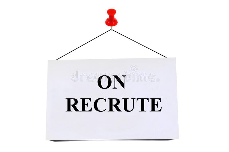 We recruit written in French. On a pinned card on white background royalty free stock image