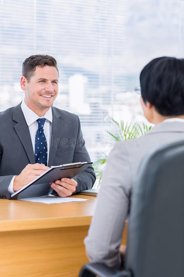 Recruiter checking the candidate during a job interview royalty free stock image
