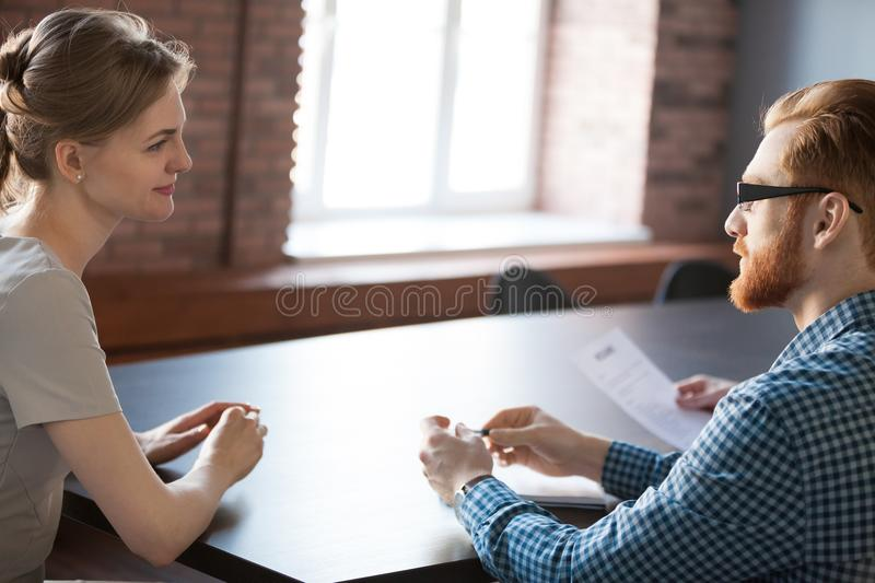 Recruiter considering female applicant candidature during interv. HR manager talking with smiling female job candidate during work interview in office, recruiter royalty free stock photo