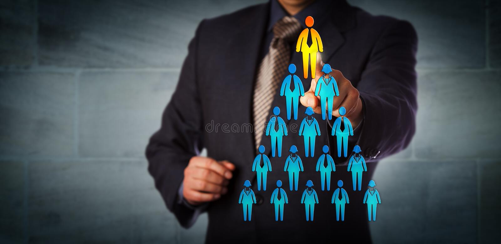 Recruiter Selecting Man Atop Corporate Hierarchy. Blue chip recruitment manager selecting the employee icon atop a pyramid structure. Business concept for talent royalty free stock image