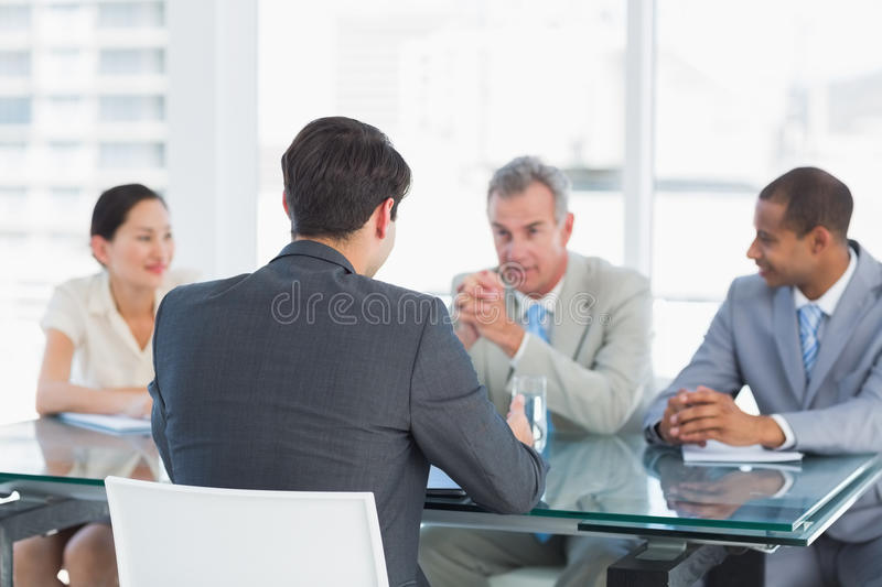 Recruiters checking the candidate during job interview stock photo