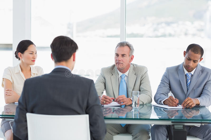 Recruiters checking the candidate during job interview royalty free stock photos