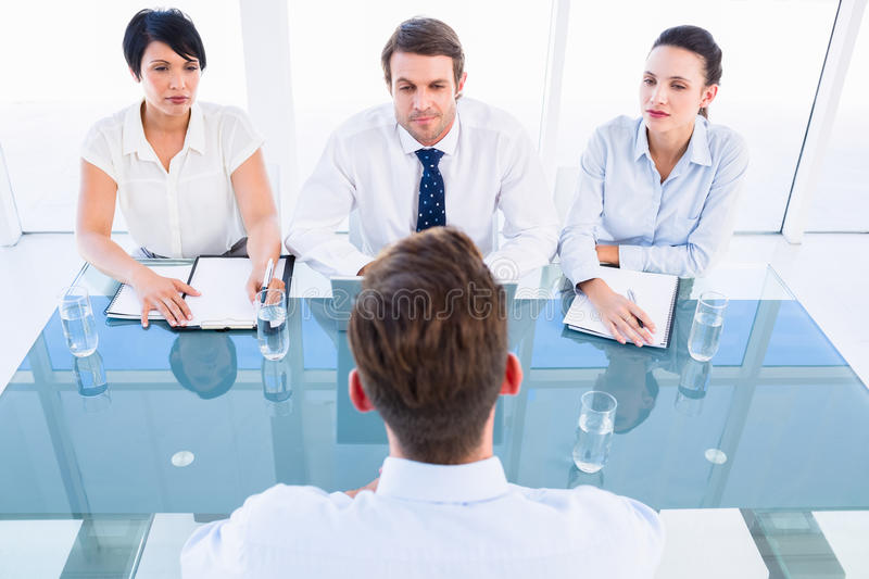 Recruiters checking the candidate during job interview royalty free stock images