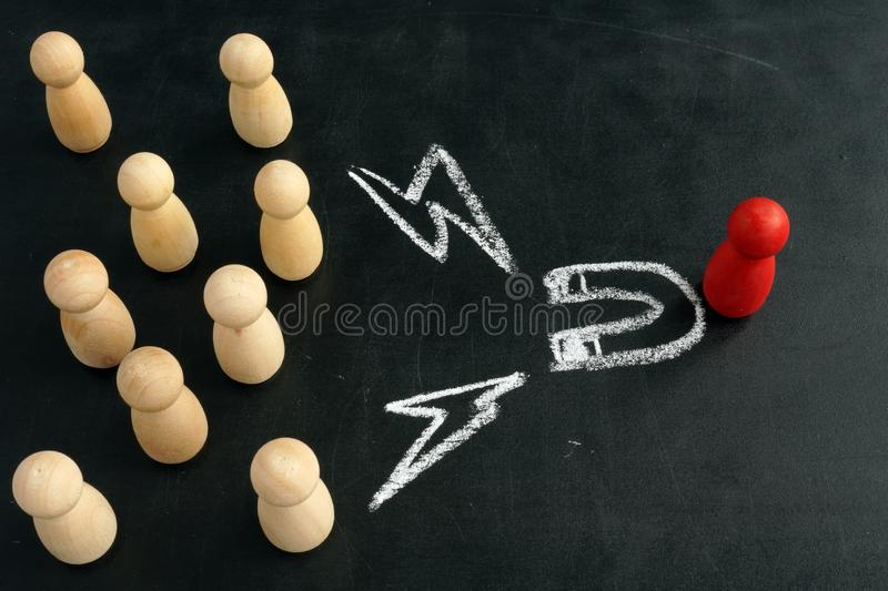 Recruitment of candidates. Wooden figurines attracting drawn magnet stock images