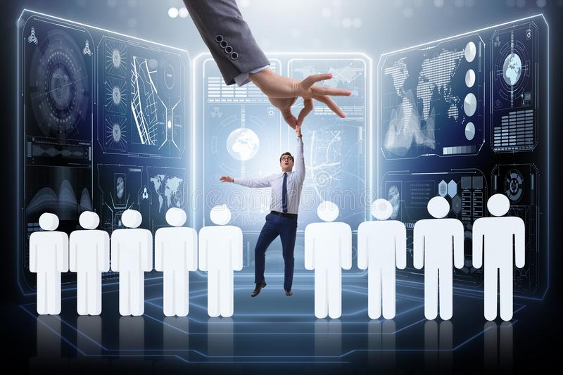 The recruitment concept with hand picking the best employee stock image