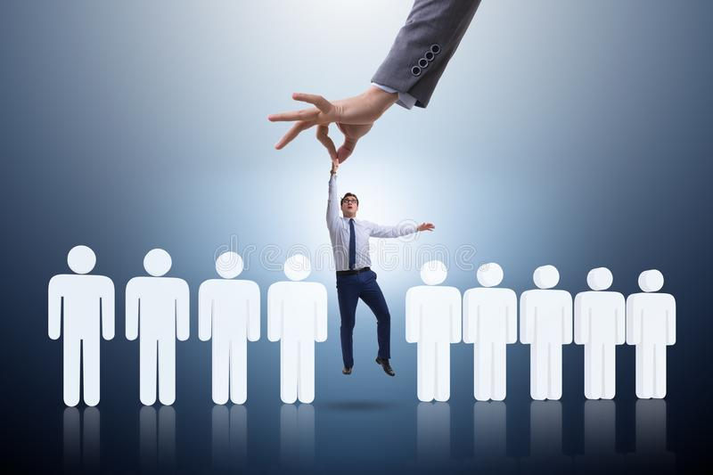 The recruitment concept with hand picking the best employee stock photo