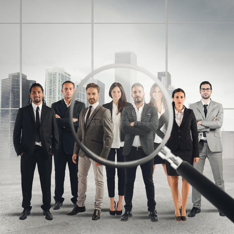 Recruitment and select candidates. Magnify lens on a only a few suitable candidates to the workplace stock image