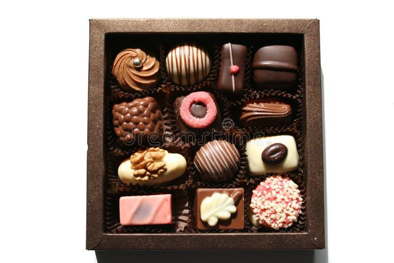 Rectángulo con los chocolates magníficos fotos de archivo