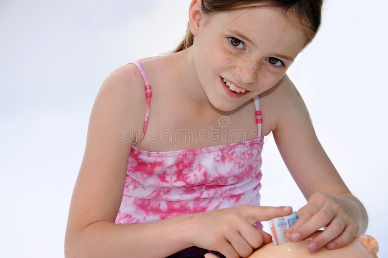 Rectángulo de dinero de la pizca de la muchacha fotos de archivo libres de regalías