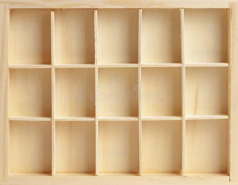 Rectángulo de madera en quince células fotografía de archivo libre de regalías