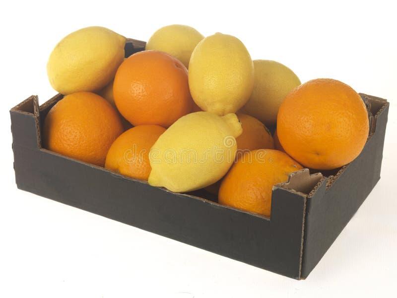 Rectángulo de naranjas y de limones imagen de archivo