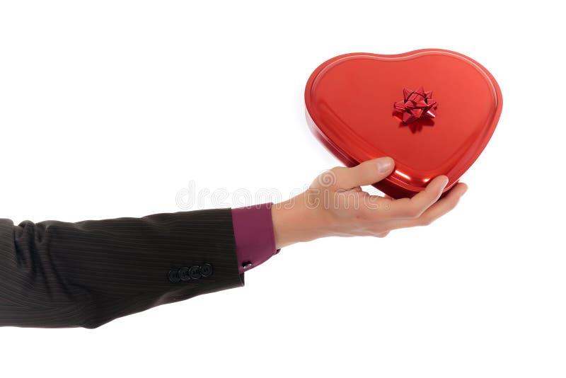Rectángulo del chocolate del corazón de la mano imagenes de archivo