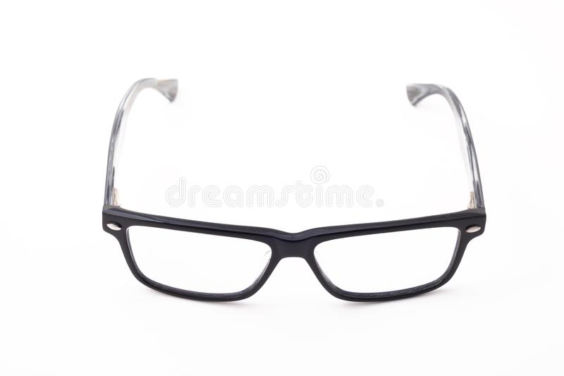 Rectangular black-rimmed glasses are located frontally on a white background. Isolated stock photography