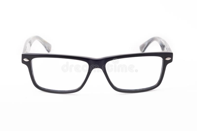 Rectangular black-rimmed glasses are located frontally on a white background. Isolated royalty free stock images