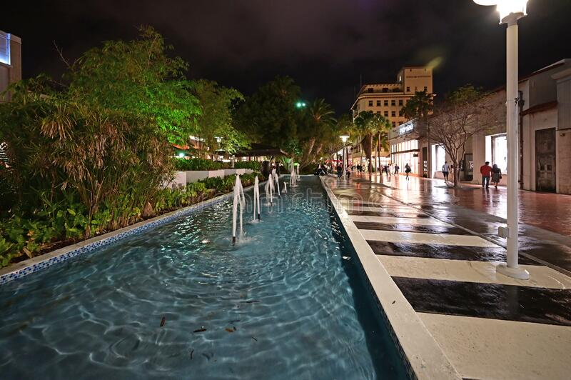 Rectangular fountain on Lincoln Road Mall in Miami Beach, Florida at night. Miami Beach, Florida - February 20, 2020 - Rectangular fountain on Lincoln Road Mall stock image