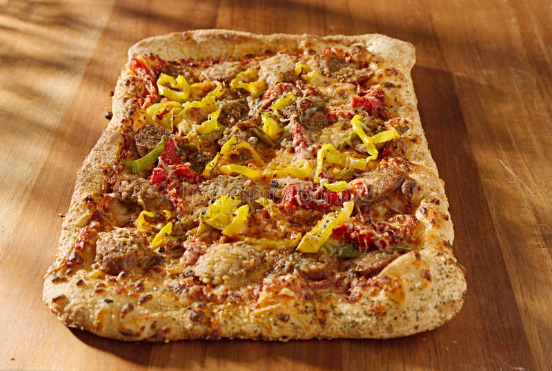 Download Rectangular Gourmet Pizza With Sausage And Colorfu Stock Photo - Image: 22799046