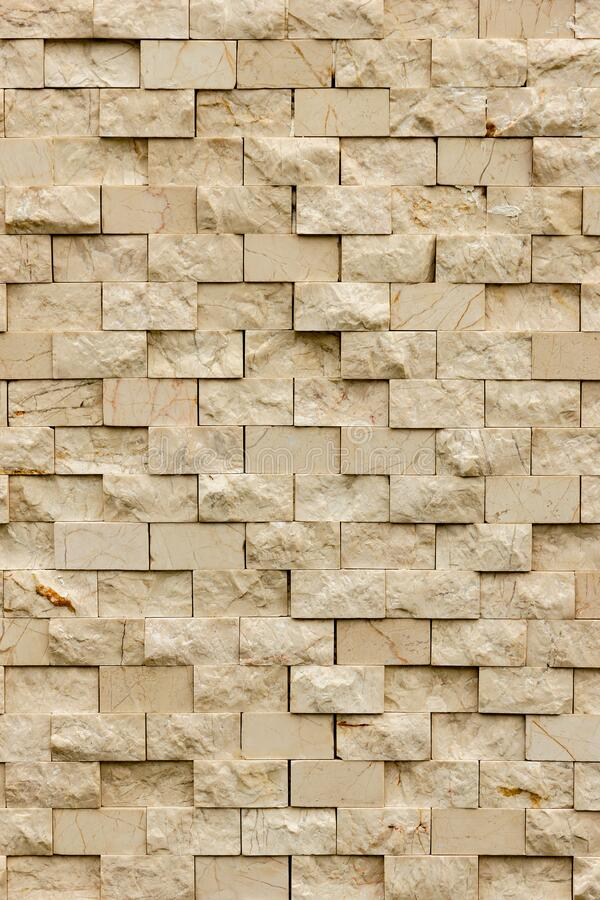 Rectangular marble tiles in beige color. Beige marble wall texture Wallpaper background. Rectangular marble tiles in beige color. Beige marble wall texture royalty free stock photography