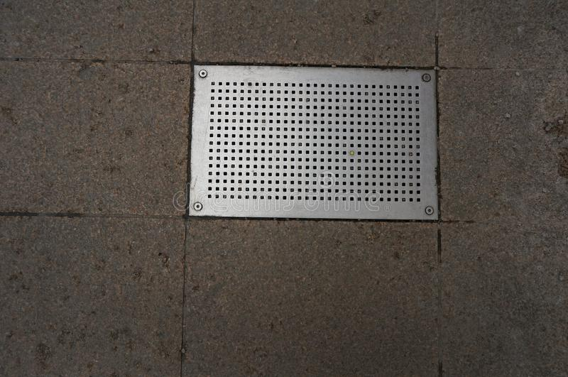 Rectangular metal grating. Of street drainage system royalty free stock photos