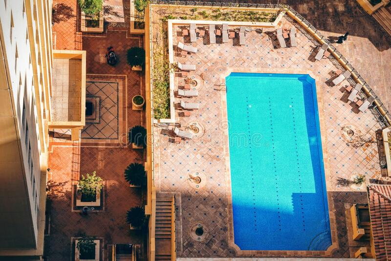 Rectangular Pool Near High Rise Building During Daytime Free Public Domain Cc0 Image