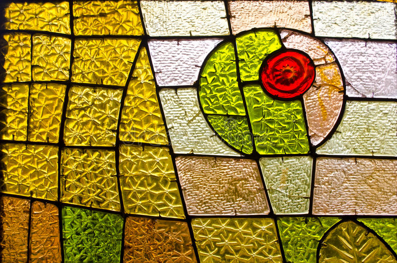 Rectangular and round stained glass window with red rose. Abstract geometric colorful background. stock photography