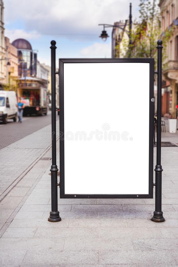 Rectangular White Mockup Poster City Advertisement Isolated On The Street. royalty free stock images