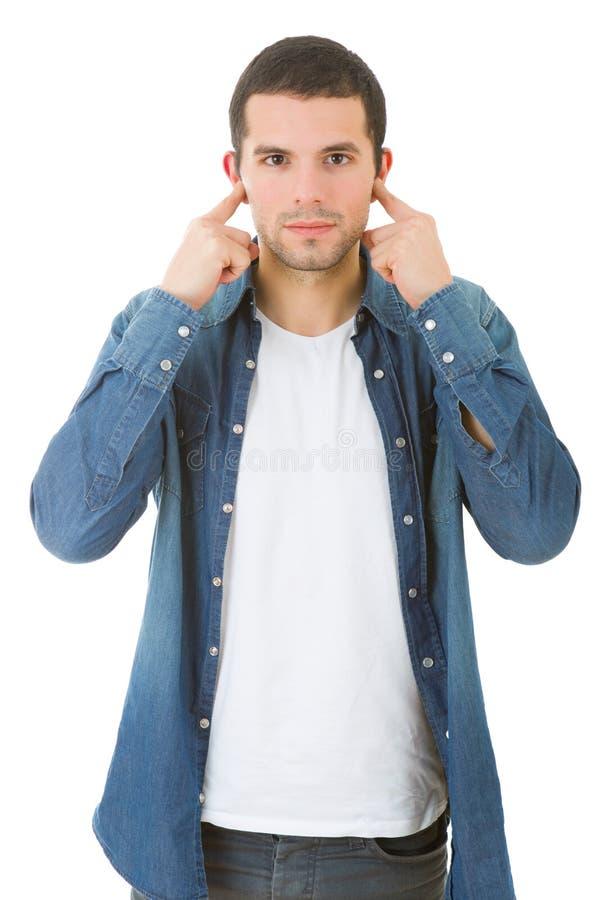 Recubrimiento de sus oídos fotografía de archivo libre de regalías