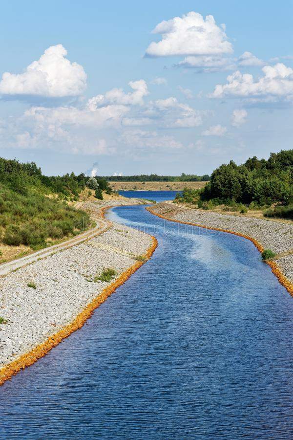 Recultivated mining landscape with watercourse royalty free stock images