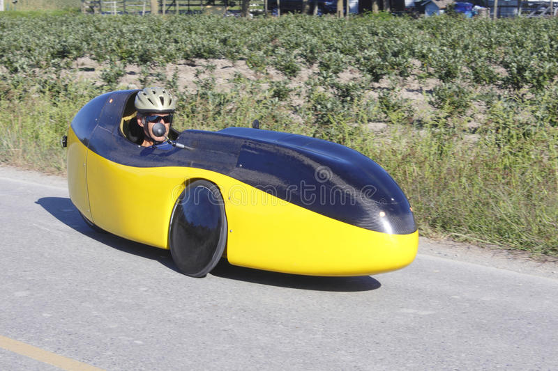 Recumbent Bicycle on the road. A recumbent bike or bicycle car travelling down the road stock images