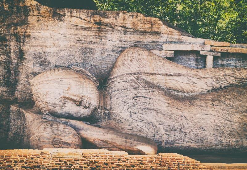 Recumbent Buddha statue at The Gal Vihara. Panorama. Recumbent image of a Buddha statue at The Gal Vihara in the world heritage city Polonnaruwa, Sri Lanka royalty free stock photo