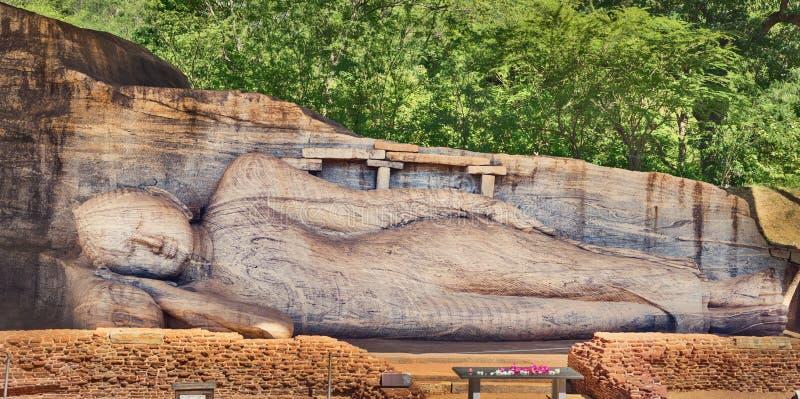Recumbent Buddha statue at The Gal Vihara. Panorama. Recumbent image of a Buddha statue at The Gal Vihara in the world heritage city Polonnaruwa, Sri Lanka royalty free stock images