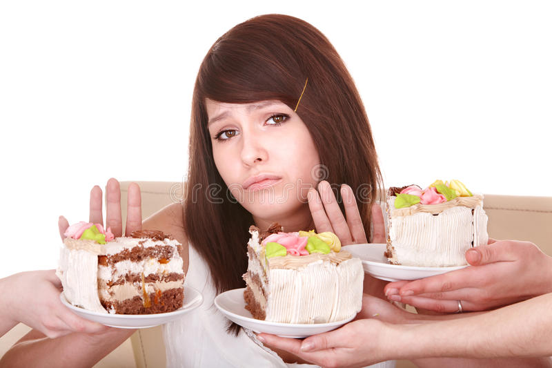 Recusa da menina para comer a torta. fotos de stock royalty free