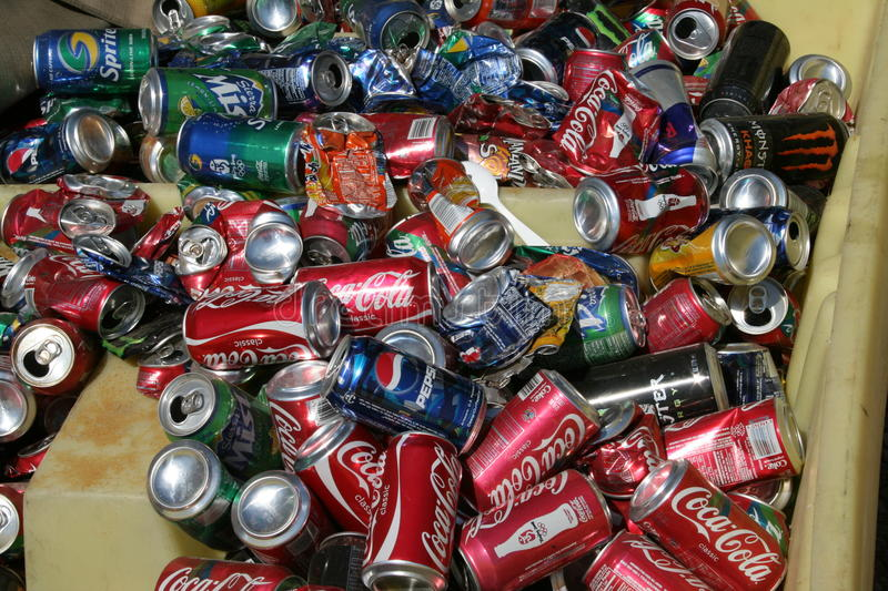 Recycle cans. Soda cans in a bin waiting to be recycled stock image