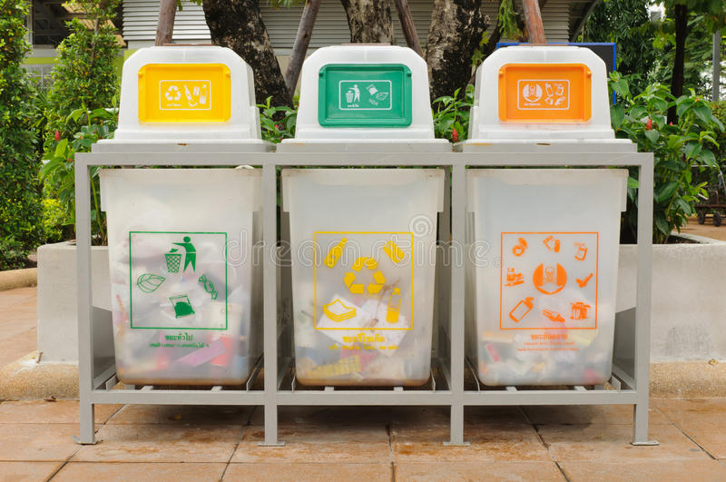 Recycle bin. Yellow and green and orange royalty free stock photo