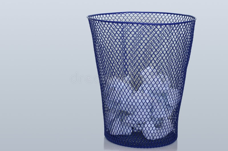 Recycle Bin. With papers in it. Please take a look at my portfolio to see an empty  also royalty free stock images