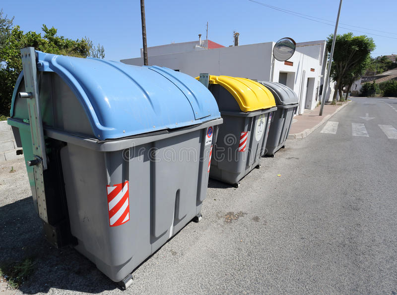 Recycle Bins. 3 recycling bins on a street stock image