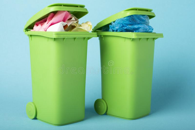 Recycle bins on blue background. Paper and polyethylene. Waste recycling. Ecological concept.Recycle bins on blue background. royalty free stock photography