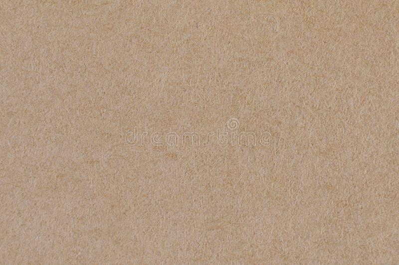 Recycle brown envelop box paper texture seamless pattern abstract background for design or text closeup see fibers. Recycle brown envelop box paper seamless royalty free stock photos