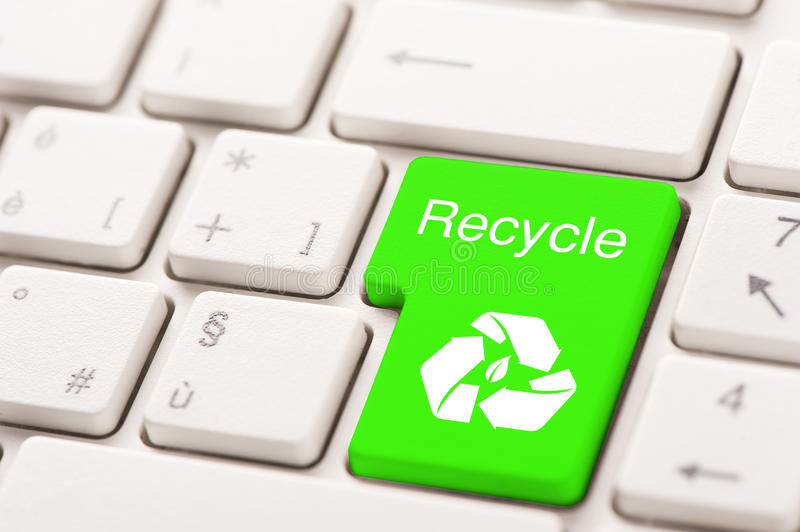 Recycle button on the keyboard. Close up stock photo