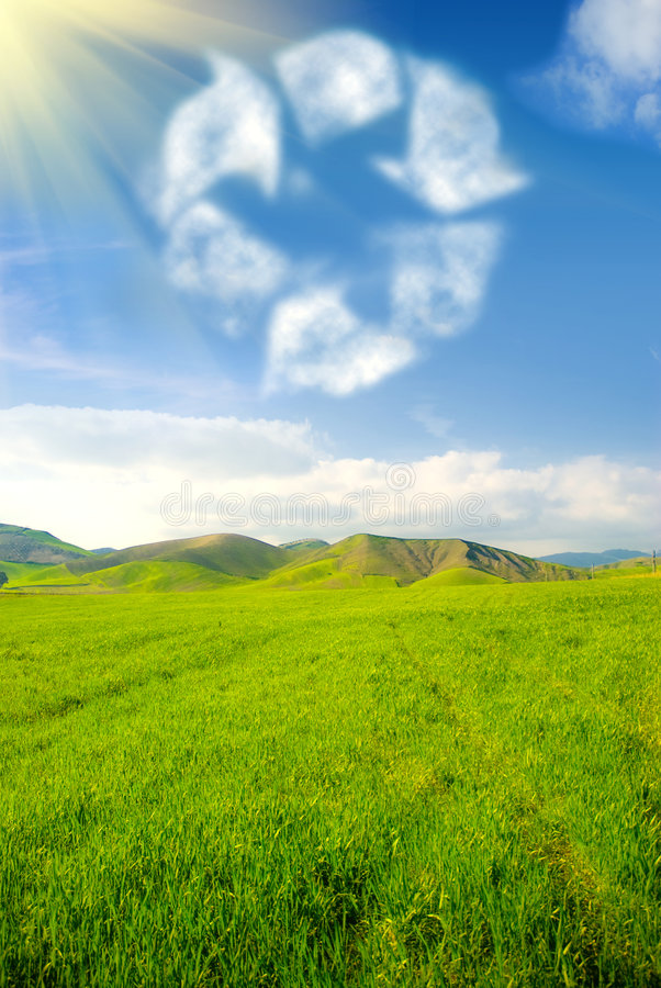Recycle concept. Recycle symbol in the sky with grassland landscape stock photos