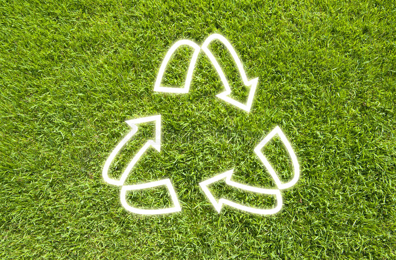 Recycle on Green grass. Texture background royalty free stock photo
