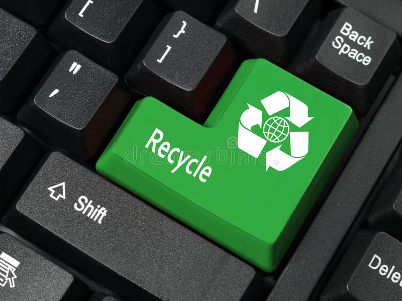Recycle key. Closeup of computer keyboard key in green color with three-arrow recycle and earth symbol and Recycle word