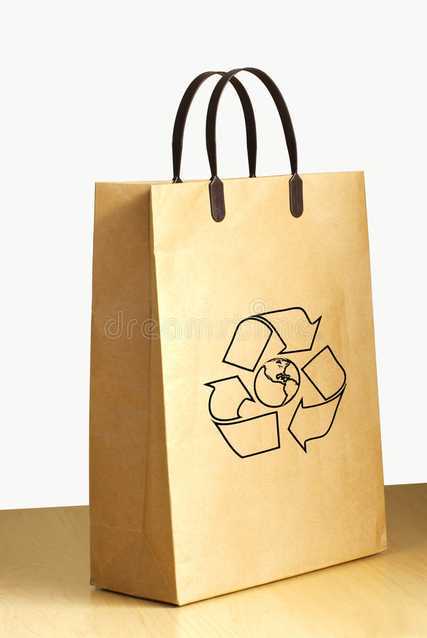 Recycle logo on paper bag royalty free stock photos