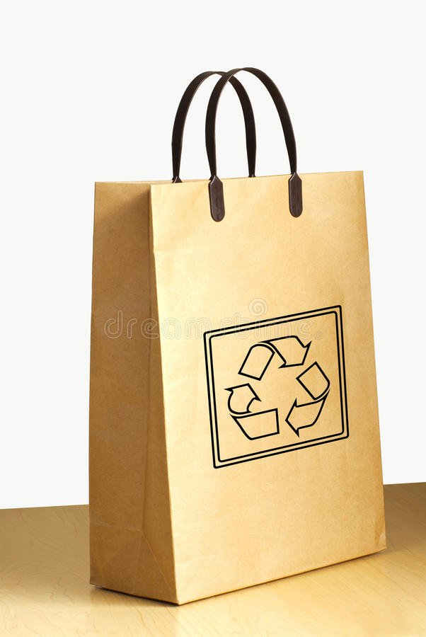 Recycle Logo On Paper Bag On Wooden Floor Stock Photo