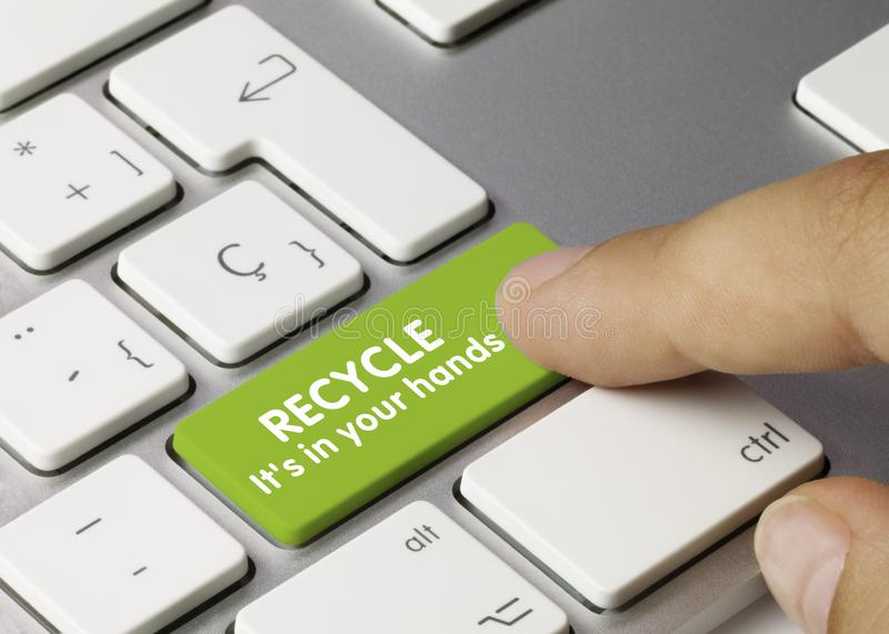 RECYCLE it`s in your hands - Inscription on Green Keyboard Key stock image