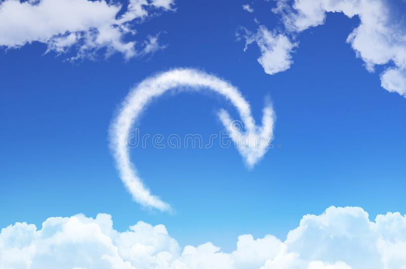 Recycle sign, reload from the clouds against the blue sky. royalty free illustration