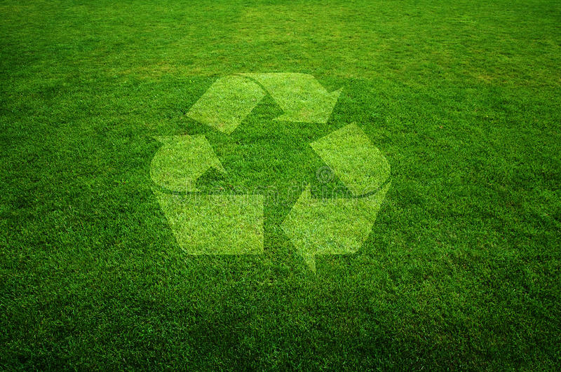 Recycle symbol. On a fresh green grass, environmental concept image stock images