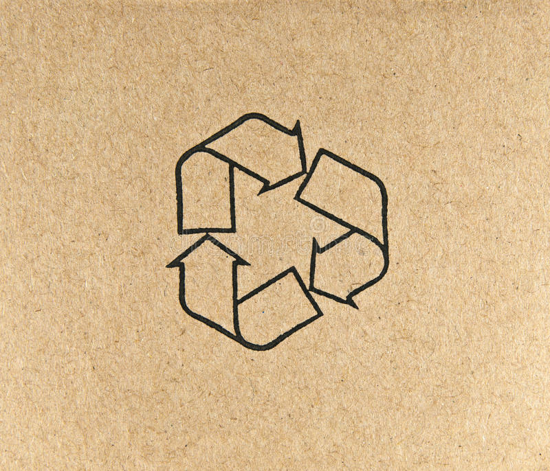 Recycle symbol on brown paper. Close up recycle symbol on brown paper royalty free stock photography