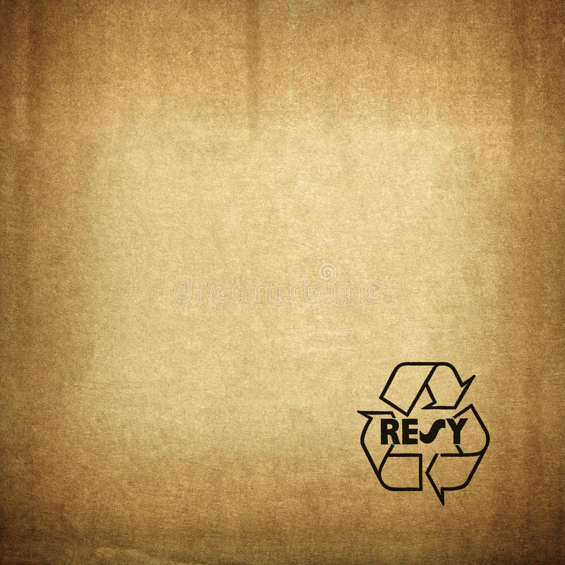 Recycle symbol on cardboard texture stock photo
